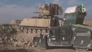 M113 APC with ZU-23-2 mounted on top